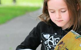 Albert Lea student reading outside